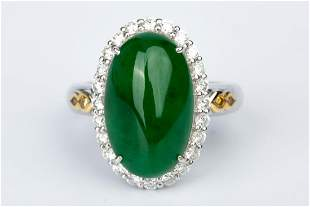"""AN """"EMPEROR GREEN"""" JADEITE RING WITH 17K WHITE GOLD"""