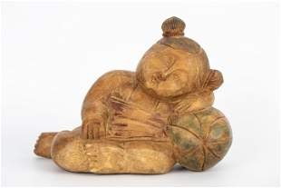 20TH CENTURY WOOD CARVED SLEEPING CHILD STATUE
