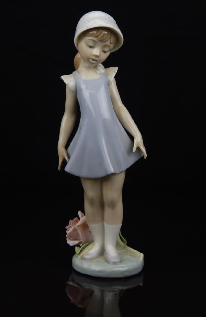 LLADRO PORCELAIN GIRL ALONG SIDE OF ROSE FIGURE