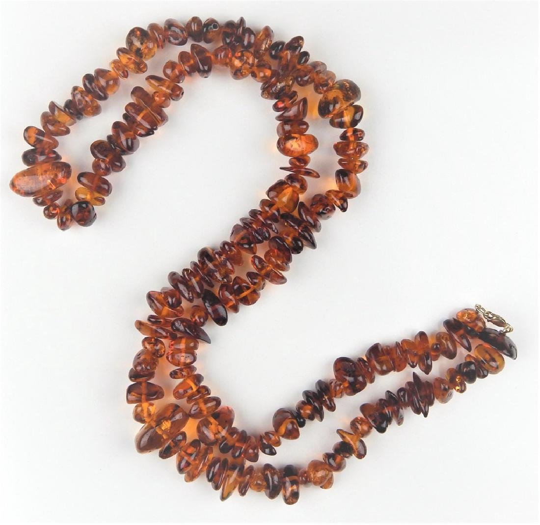 LARGE AMBER NECKLACE W/ 14K CLASP
