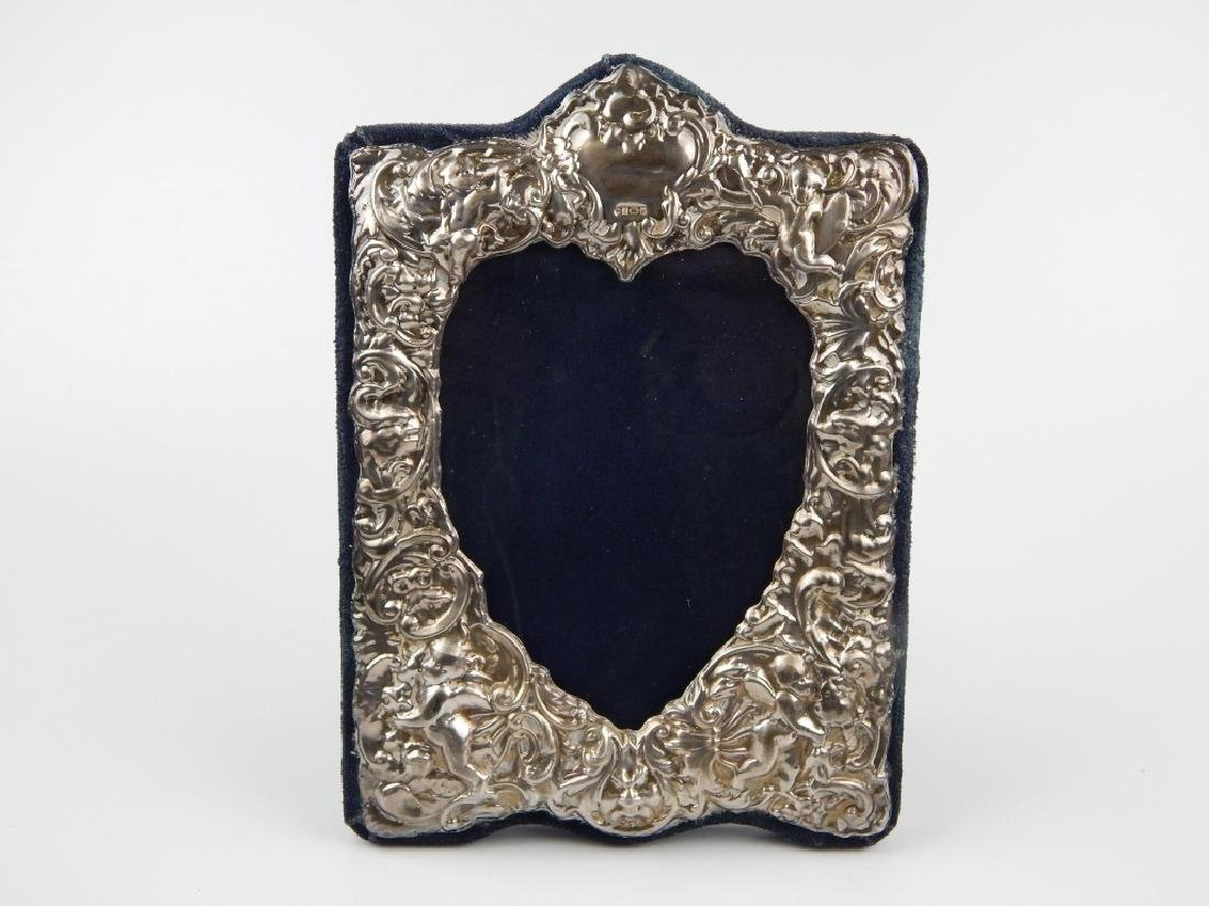 3 ENGLISH REPOUSSE STERLING SILVER PICTURE FRAMES - 3