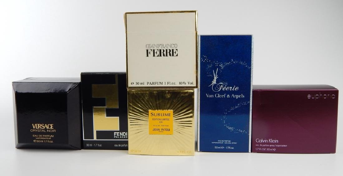 LOT OF 7 DESIGNER PERFUME SCENTS IN BOXES