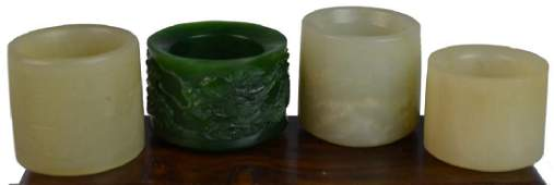 4 18th/19th C CHINESE CARVED JADE ARCHER'S RINGS