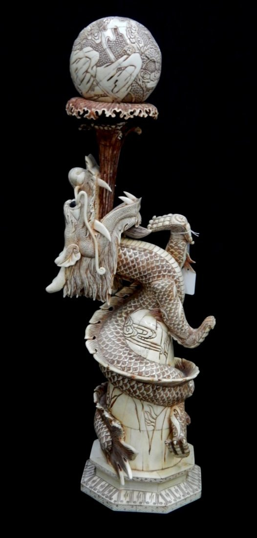 CHINESE CARVED BONE DRAGON HOLDING BALL SCULPTURE