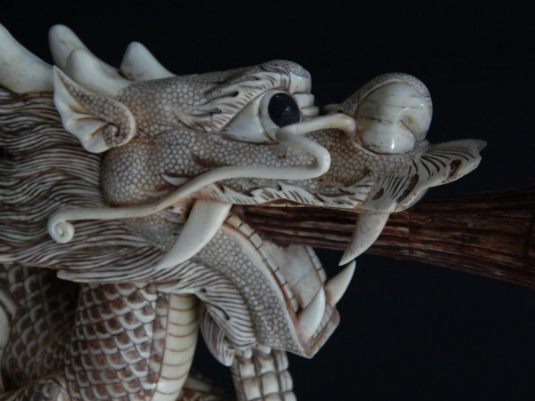 CHINESE CARVED BONE DRAGON HOLDING BALL SCULPTURE - 2