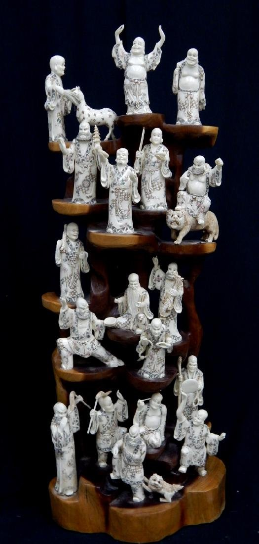 PALATIAL CHINESE CARVED BONE 18 ARHATS ON WOOD STA