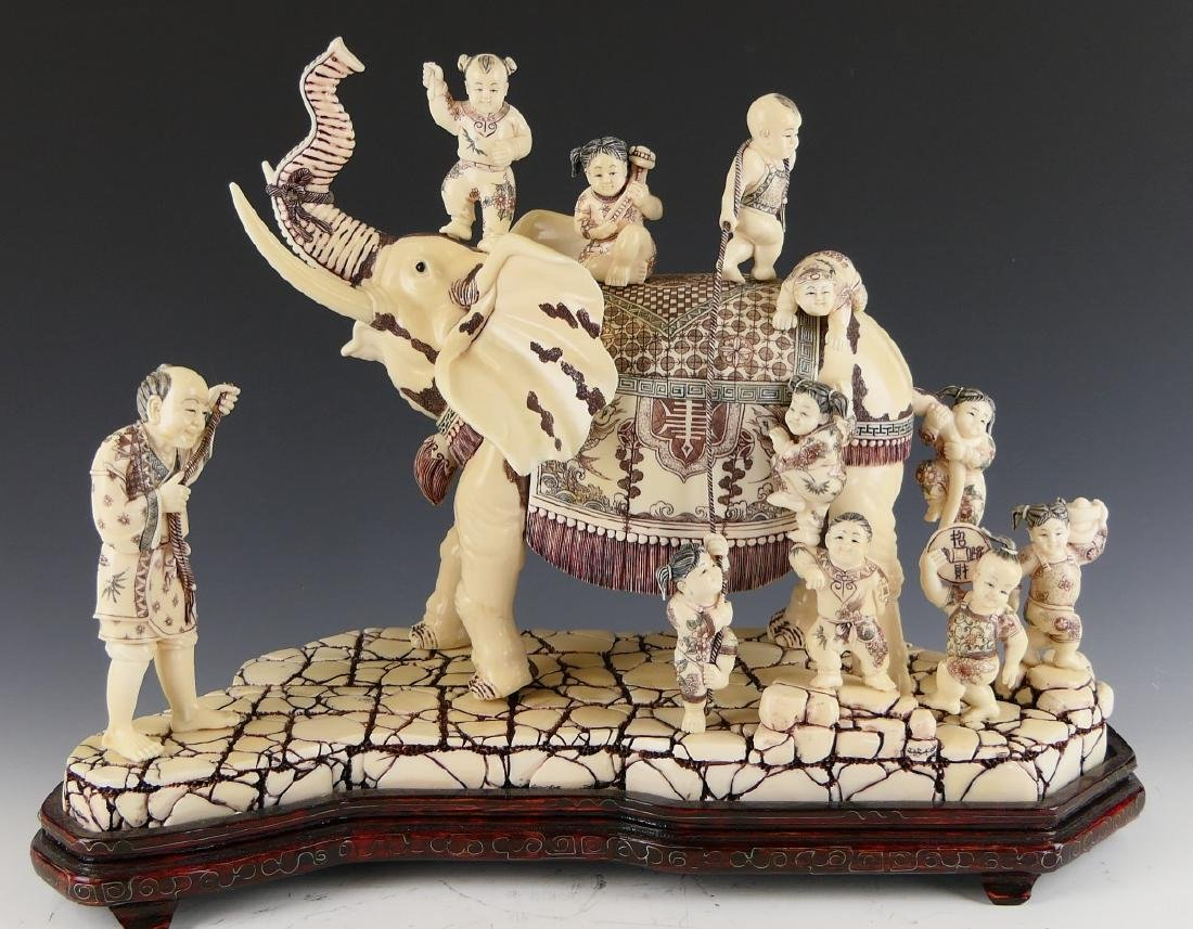 CHINESE CARVED BONE ELEPHANT WITH CHILDREN FIGURE