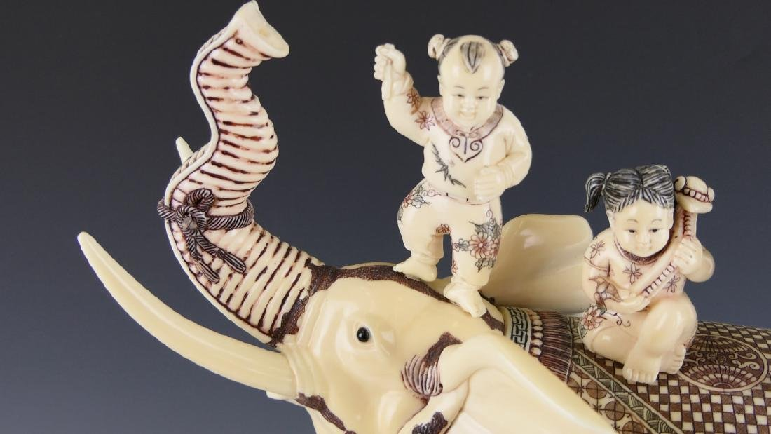 CHINESE CARVED BONE ELEPHANT WITH CHILDREN FIGURE - 2