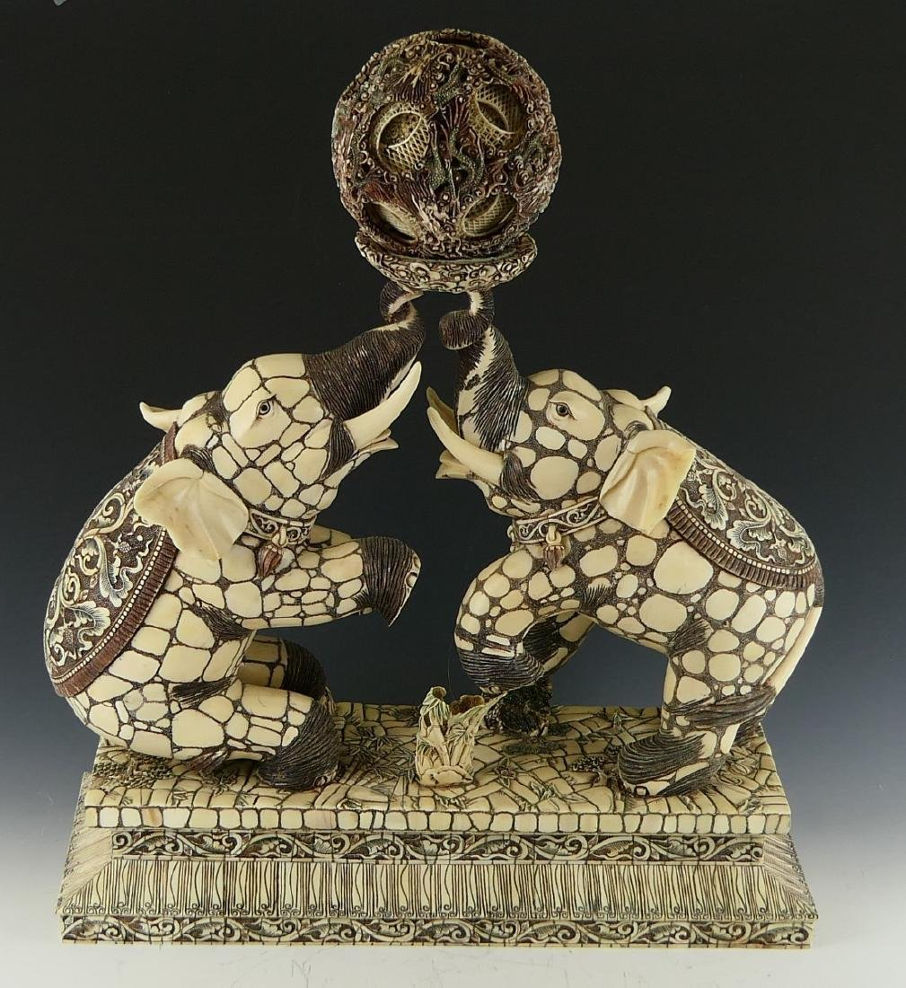 CHINESE CARVED BONE DUELING ELEPHANTS W/ BALL