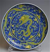 CHINESE BLUE & YELLOW GLAZE DRAGONS CHARGER