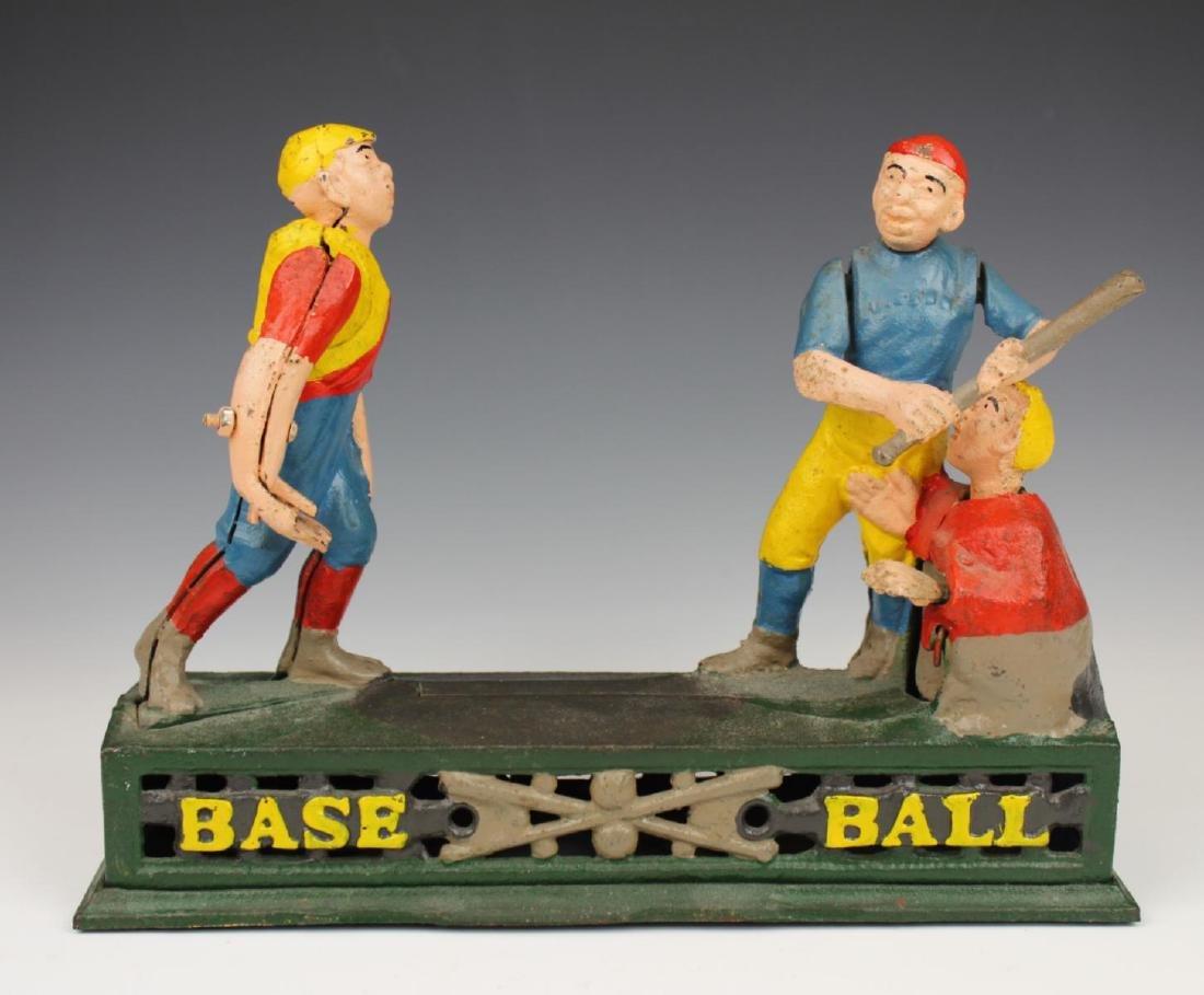 VINTAGE CAST IRON TOY BASEBALL BANK