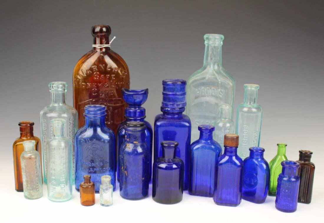 22 ANTIQUE GLASS MEDICINE BOTTLES