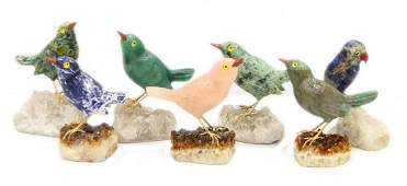 7 CHINESE CARVED MULTI STONE BIRDS ON QUARTZ BASES