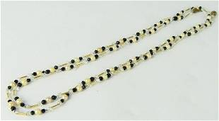 VTG 14KT YG PEARL AND ONYX OPERA LENGTH NECKLACE