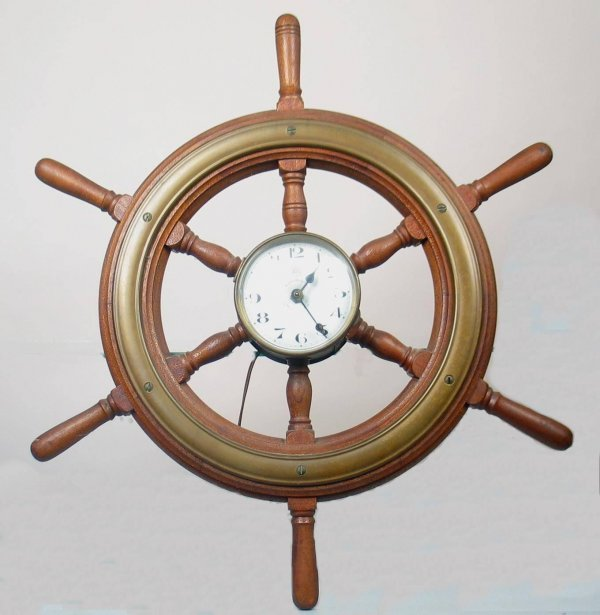 1X: Ships wheel clock 25 inches in diameter in excellen