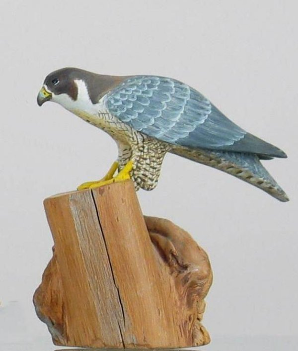 "444: Miniature falcon on a driftwood base signed ""H. Gi"