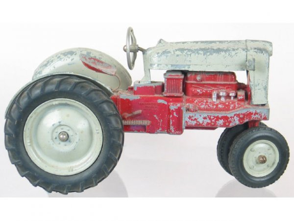 23: Tractor Toy by Hubley Co. Grey and red toy metal tr