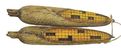 471: Two carved ears of field corn by Leo McIntosh, Ups