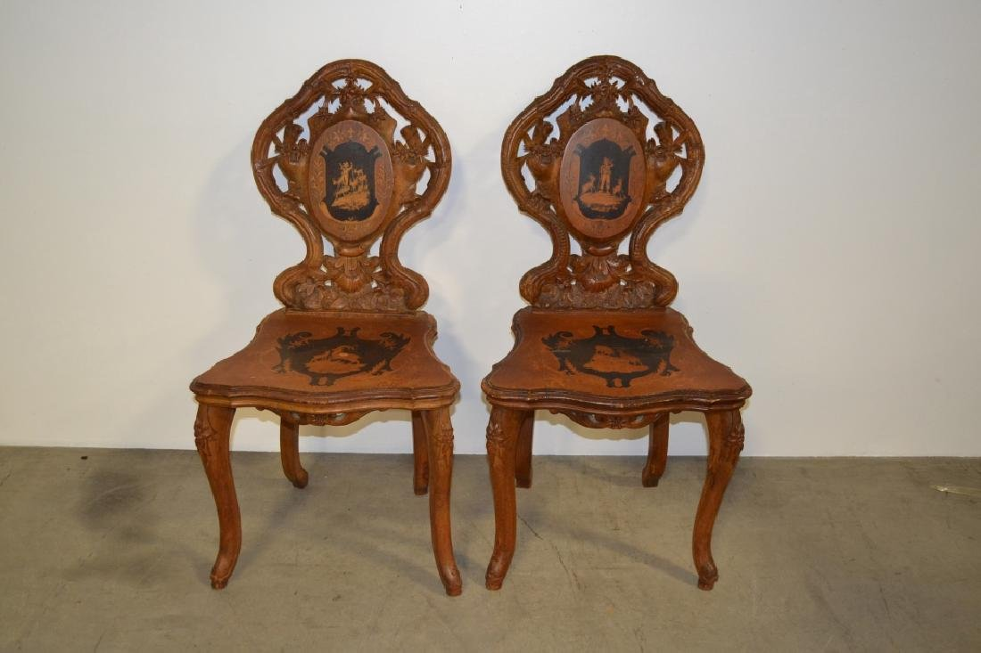 PAIR CARVED BLACK FOREST INLAID CHAIRS