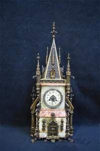 FRENCH BRONZE ONYX AND MARBLE GOTHIC REVIVAL CLOCK
