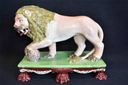 19TH C. STAFFORDSHIRE PEARLWARE LION