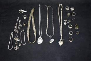 SHOWCASE OF STERLING RINGS AND NECKLACES