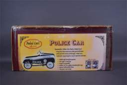 NEW IN BOX POLICE CAR PEDAL CAR