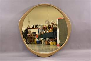 A CEPA BRONZE MIRROR BY CONNECT FURNITURE