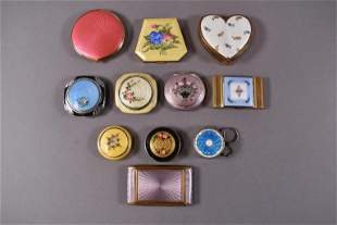 11 ENAMELED COMPACTS
