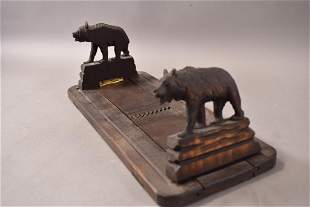 EXPANDABLE CARVED BEAR BOOK RACK