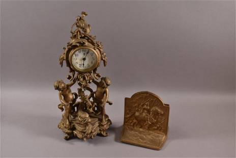 CAST METAL FIGURAL CLOCK & PAIR OF BOOKENDS