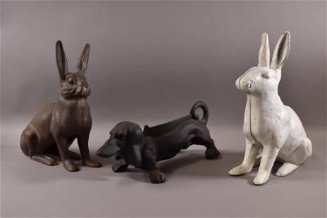 3 CAST IRON ANIMALS (RABBITS & DOG)