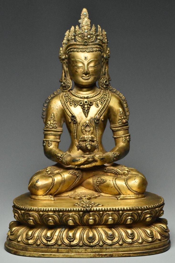 MING DYNASTY GILT BRONZE FIGURE OF BUDDHA 15TH C