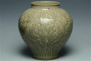 A JIN DYNASTY YAOZHOU CELADON CARVED JAR AND BOX