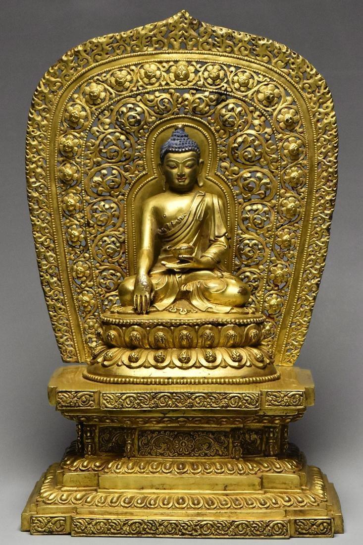 A MING GILT BRONZE FIGURE OF BUDDHA YONGLE PERIOD