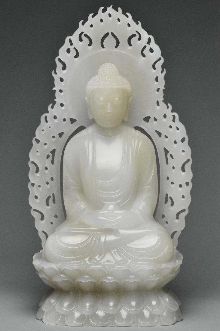 A QING DYNASTY WHITE JADE FIGURE OF BUDDHA 18TH C