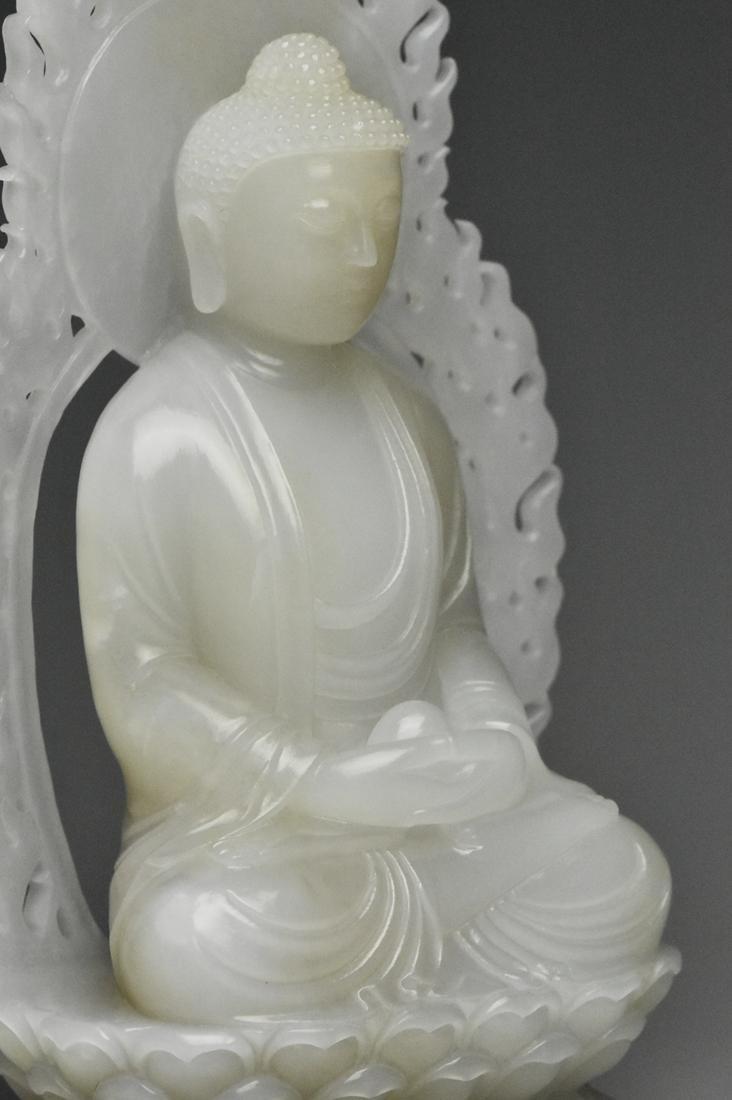 A QING DYNASTY WHITE JADE FIGURE OF BUDDHA 18TH C - 9