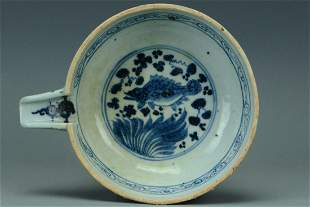 A YUAN DYNASTY BLUE AND WHITE POURING BOWL