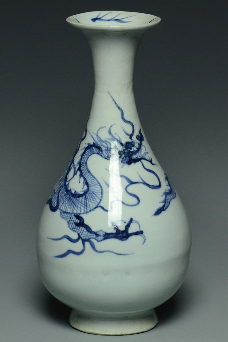 A YUAN DYNASTY BLUE AND WHITE DRAGON VASE