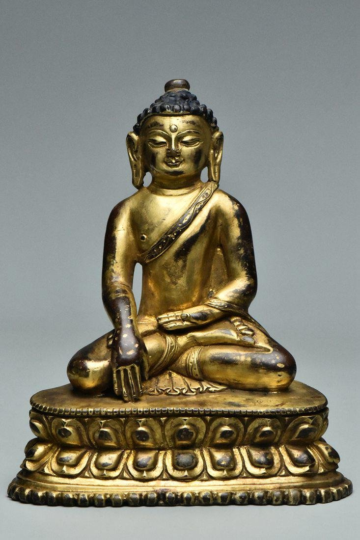 A MING DYNASTY GILT BRONZE FIGURE OF BUDDHA