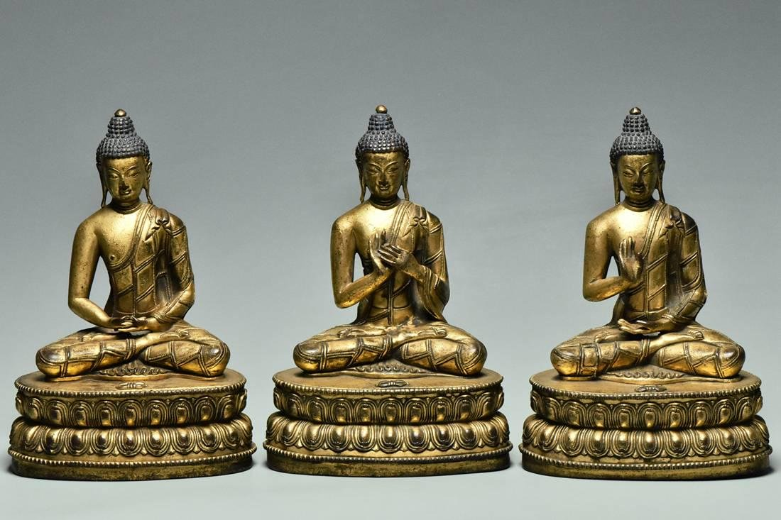SET OF THREE GILT BRONZE FIGURES OF BUDDHA 15TH C
