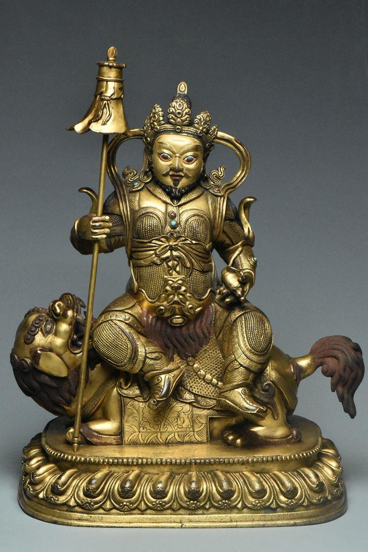 A MING DYNASTY GILT BRONZE FIGURE OF WEITUO