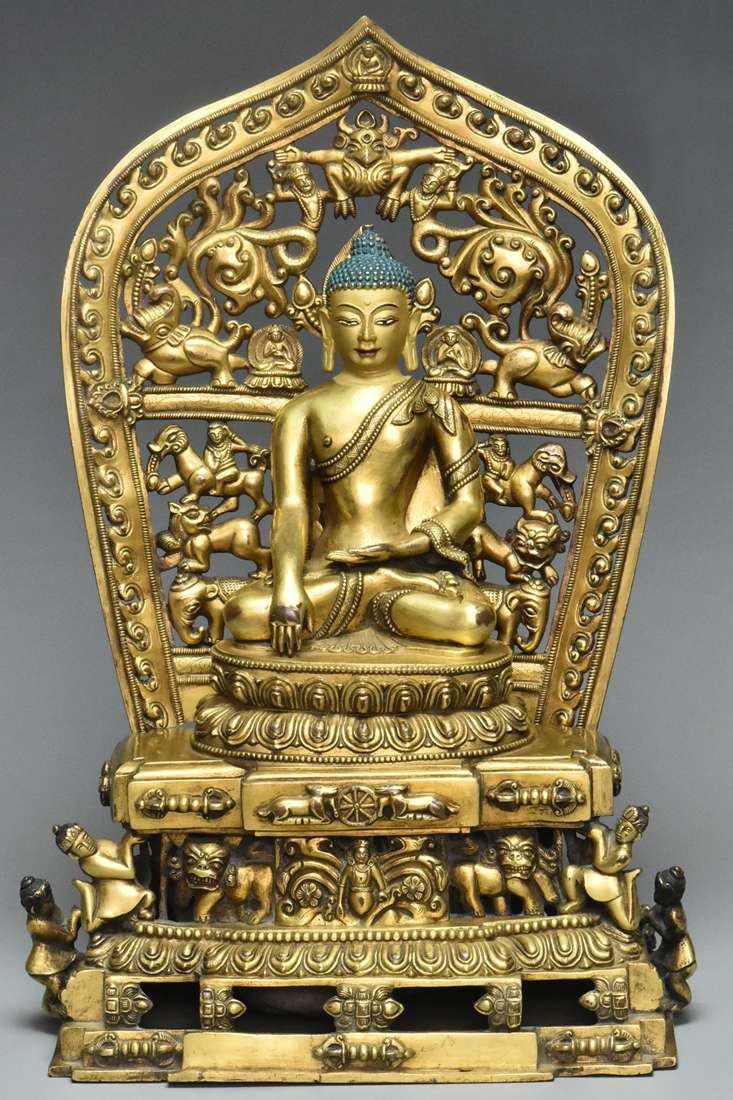 A MING DYNASTY GILT BRONZE FIGURE OF BUDDHA 15TH C