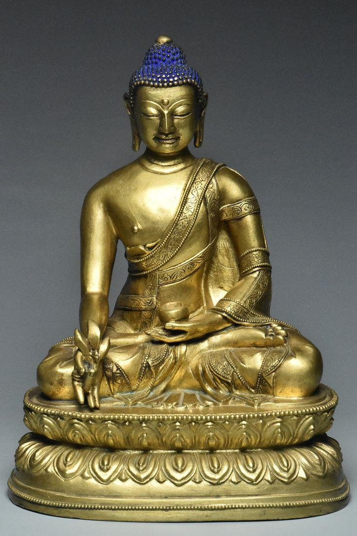 A MING DYNASTY GILT BRONZE FIGURE OF BUDDHA