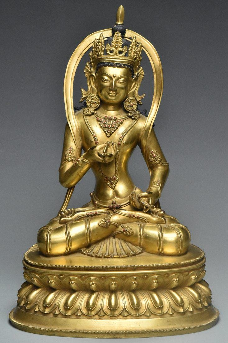 A MING DYNASTY GILT BRONZE FIGURE OF AMITAYUS