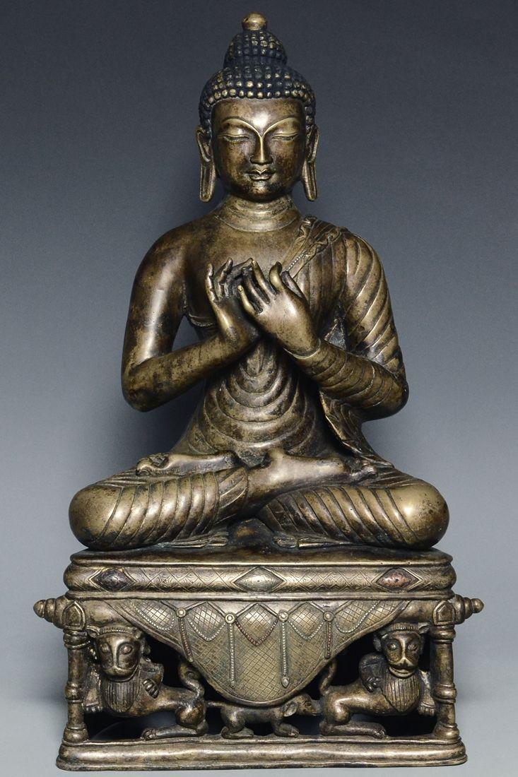 A YUAN DYNASTY BRONZE FIGURE OF BUDDHA