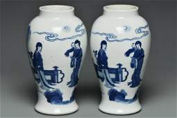 A PAIR OF BLUE AND WHITE FIGURE SUBJECT VASES