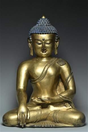 A LARGE GILT BRONZE FIGURE OF BUDDHA 14TH C