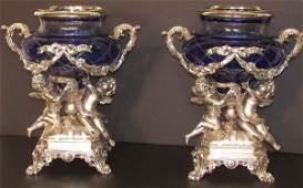 919: Pr. figural silverplate urns w/cobalt glass bowls