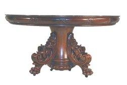 1369: Mahog. diningroom table w/reclining cherub base